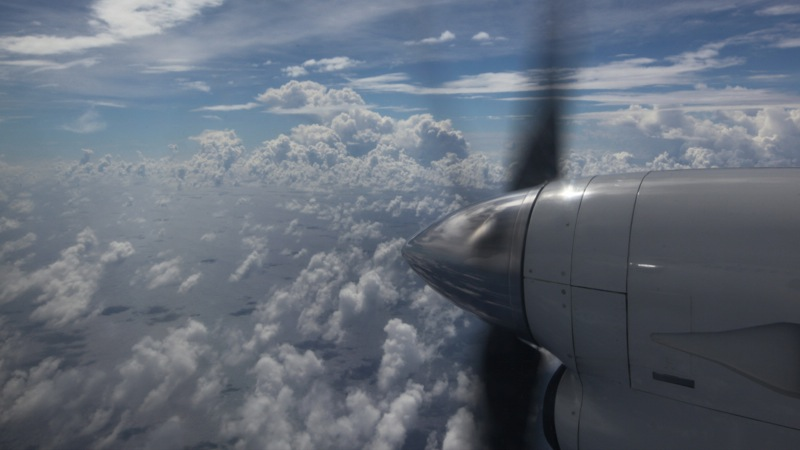 Flying over the Pacific (propeller out of window)
