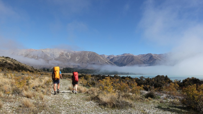 Fog lifting as Nicky & Cookie skirt around Lake Ohau