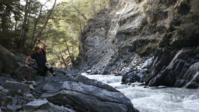 Nicky Climbing Rocky Riverbed