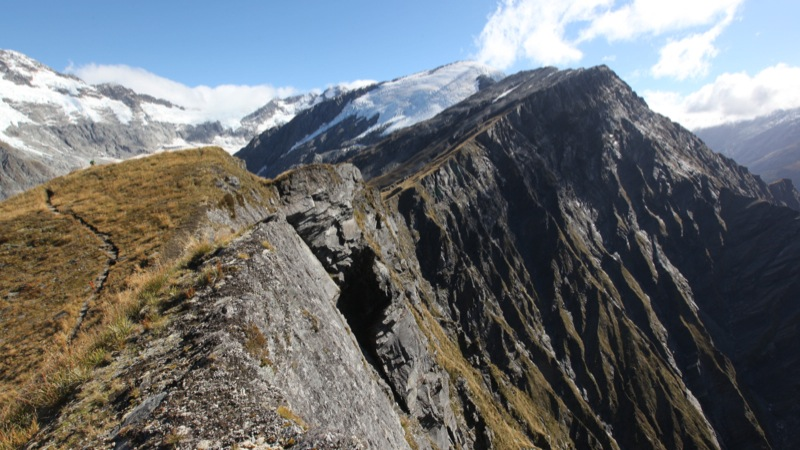 Heads Leap', a 1000m sheer rock face leading down to a valley