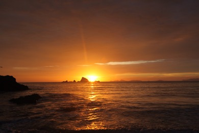 Sunrise over Awanue Rock at Ocean Beach